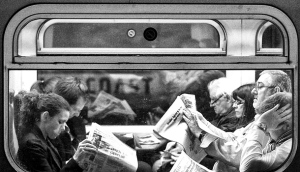 train-newspaper-readers